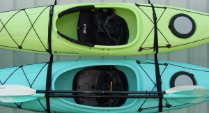 A good example of properly hanged kayaks. Straps are located at 1/3 points (over bulkheads) and kayaks are on edge.