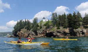 Paddling past Bear Island Light in Acadia National Park