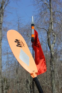 Orange Flags and bright colored paddles with retroreflecttive tape can help increase your visibility to passing boaters
