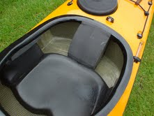 A composite sea kayak featuring a molded seat pan and custom-shaped back support.