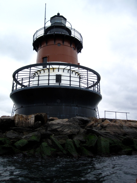 Plum Beach Light, with its characteristic 'spark plug' shape.